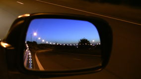Car mirror view driving at night stock video footage