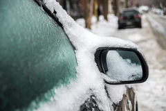 Car mirror and windows are covered with ice after freezing rain. Royalty Free Stock Photo
