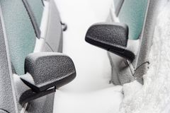 Car mirrors of two cars buried in the snow after snowstorm Montreal, CA royalty free stock photos