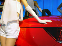 Car and model. On the exposition Royalty Free Stock Photography