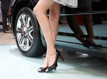 Car and model. Model and car on the auto exposition royalty free stock image
