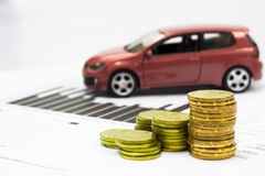 Car Model and Financial Statement With Coins Stock Photography