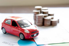 Car model and Financial statement with coins. (finance and car loan concept Royalty Free Stock Photos