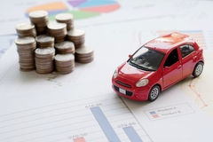 Car model and Financial statement with coins. (finance and car loan concept Royalty Free Stock Images