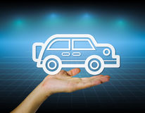 Car. Model of car in hand on modern dark background Stock Images