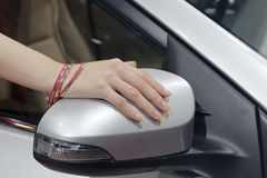 Car model hand on the rear-view mirror Royalty Free Stock Image
