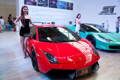 Car model and Roadster. Take on the 16th Chongqing International Motor Show, June 6th-12th, 2014. There are many international famous brand companies and Stock Photo