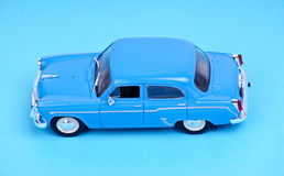 Car model toy. On blue background Stock Photography