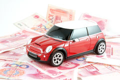 Car and money. Red car and RMB notes Stock Image