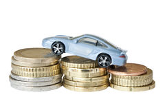 Car and money. Luxury car on top of the money showing the  higher  prices  isolated on white Stock Image