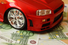 Car and money. Money and red toy car Stock Photography