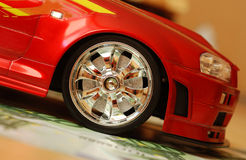 Car and money. Money and red toy car Stock Images