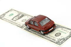 Car and money. Small car on money against white background Stock Photography