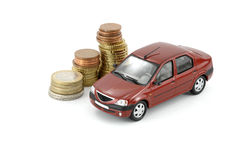 Car and money. Small car and coins on white background royalty free stock image