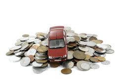 Car and money. Car on pile of coins and money royalty free stock photos