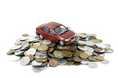 Car and money. Small car on pile of coins stock photos