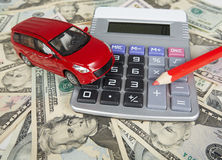 Car money and calculator. Payments and costs Royalty Free Stock Photos