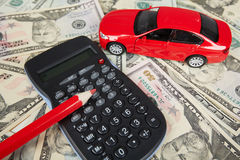 Car money and calculator. Royalty Free Stock Images