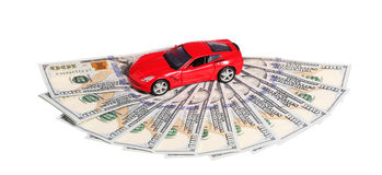 Car on money cash  isolated on white Stock Photo