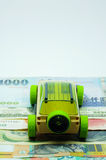 Car on money highway. A wooden SUV driving toward a bright future on a money highway Stock Photos