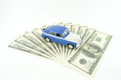 Car and money. The layout of the car is on banknotes Stock Photos