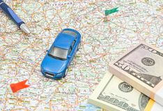 Car, money and pen on map Stock Photo