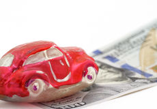 Car on money. Red car on one hundred dollars bill Royalty Free Stock Photo