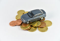 Car and money. Toy car and money concept for buying, renting, fuel or service and repair costs Royalty Free Stock Image