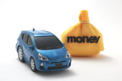 Car and money. Toy car and money on white background Stock Photo