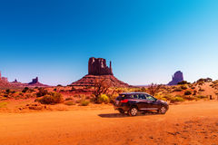 Car on the Monument Valley drive. The Valley Drive is a scenic dirt road through Navajo Tribal Park between Arizona and Utah. Car on the Monument Valley drive Royalty Free Stock Images