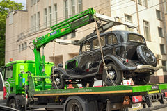 Car. Moscow, Russia - May 27, 2016: vintage german motor car Horch 853 on the tow truck on the streets of Moscow Royalty Free Stock Photo