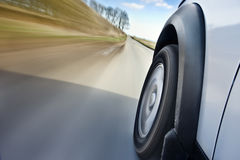 Car in motion. On the road representing blurred background stock image
