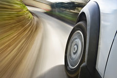 Car in motion. On the road representing blurred background Stock Images