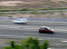Car in Motion. Small maroon car in motion Royalty Free Stock Photo