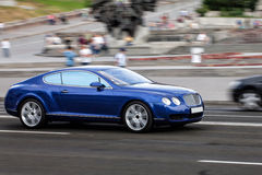 Car in motion. Blue Bentley. VIP car in motion. road coupe rides around town Stock Photography