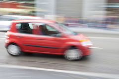 Car in motion blur, car driving fast in city Stock Photography
