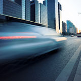 Car motion blur in dusk Royalty Free Stock Photo
