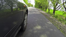 Car in motion on coutryside road. Driving in the country, low camera angle stock video footage