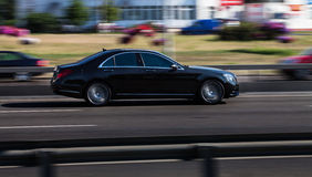 Car in motion. Mercedes-Benz. VIP car in motion. road coupe rides around town stock images