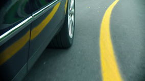 Car in motion - Wheel on the road stock video footage