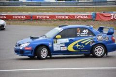 Car motosport photos. This photos show cars racing on a local street racing circuit royalty free stock photography