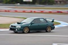 Car motosport photos. This photos show cars racing on a local street racing circuit stock photo