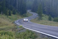 Car Mountain Drive. Car driving thru the mountains on a curvy road stock photography