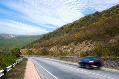 Car on mountain road. Crimea, Ukraine Stock Photos
