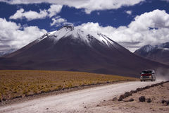 Car in the mountains. Car on the gravel road between volcanos in Chilean Atacama desert Stock Images