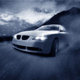 Car on the move. Car in the alps/photographic-retouching royalty free illustration