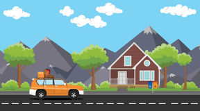 Car move with a pack of lot goods on the road with house and tree mountain as background Stock Photos