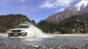 The car moved through the mountain river in the Himalayas stock video