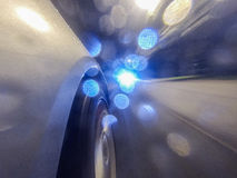 Car movement at night with blue bokeh. This image taken during car movement where the camera attached to the side of the car Stock Photos