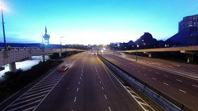 Car movement in Urban Highway during sunrise stock footage